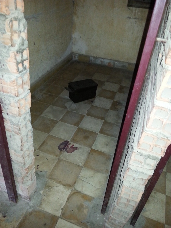 Blood stains still evident on the floor of a cell
